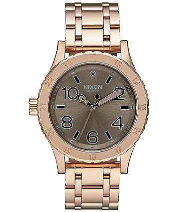 Nixon 38-20 reloj analógico en color oro rosa y gris pardo