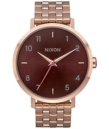 Nixon Arrow reloj en marrón y oro rosa