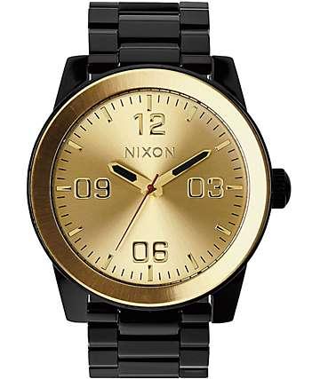 Nixon Corporal SS reloj analógico en negro y color oro