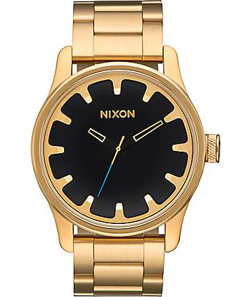 Nixon Driver reloj en oro y negro