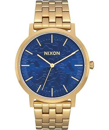 Nixon Porter reloj analógico en color oro y azul camuflado