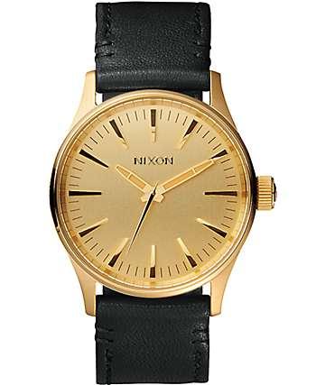 Nixon Sentry 38 Leather reloj analógico en negro y color oro