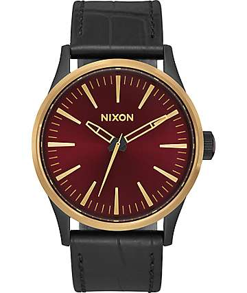 Nixon Sentry 38 Leather reloj en negro, dorado y color vino