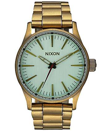 Nixon Sentry 38 SS Brass & Green Crystal Analog Watch