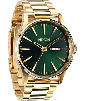 Nixon Sentry SS reloj analógico en colores oro y verde