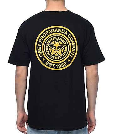 Obey Propaganda camiseta en negro y color oro