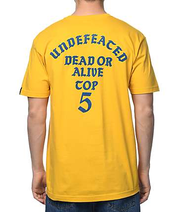 Undefeated Dead Or Alive camiseta en color oro