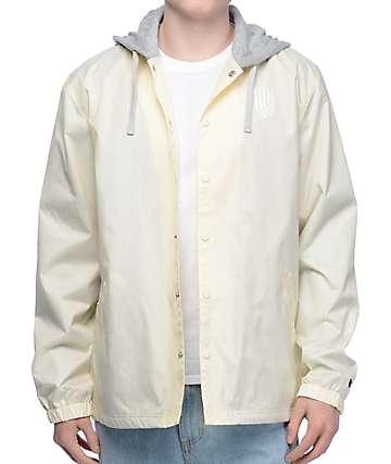 Undefeated chaqueta entrenador con capucha en color crema