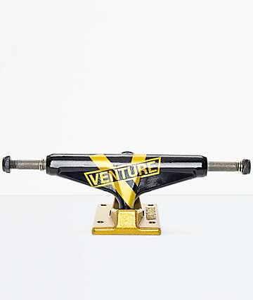 Venture 5.0 ejes de skate en negro y color oro