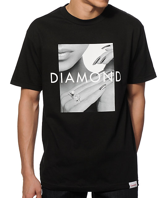 "Shine Bright Like a Diamond this year in this fashionable t-shirt! This positive happy tee is the kind of shirt a girl buys two of—you'll love it that much. Featuring the words ""Shine Bright like a Diamond,"" this beautiful women's t-shirt has been expertly designed to last and."