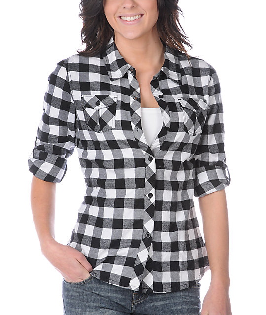 A black and white checked shirt from Polo Ralph Lauren gives that perfect boho look made for canvas sneakers and straight jeans. Or check out a larger grid pattern in dapper tan for great style, whenever.