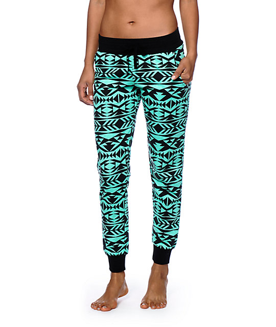 Tribal Jogger Pants Tribal Jogger Tribal Joggers Images Joggers with a tribal print can easily be your party wear as well. A black or white top goes well with a pair of such joggers. Tribal Joggers Photos Tribal Joggers Pictures For a winter night out, full-sleeve tops, boat shoes will ideally complement tribal .