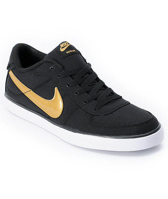 nike gold and black shoes