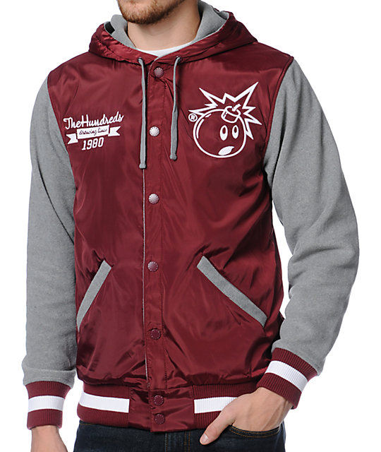 Get your roll on in classic style and extra comfort with The Hundreds Reloaded 2 varsity jacket for guys in a smooth heather grey and maroon colorway. The Reloaded 2 standard fit jacket features a nylon body, a custom