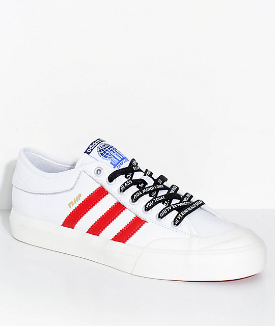 Adidas Shoes With A Tag At The Front