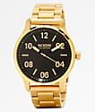 Nixon Patrol reloj analógico oro y negro