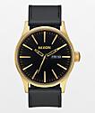 Nixon Sentry Leather reloj analógico en negro y color oro