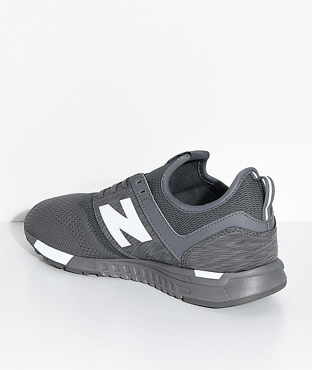 new balance gris y negra