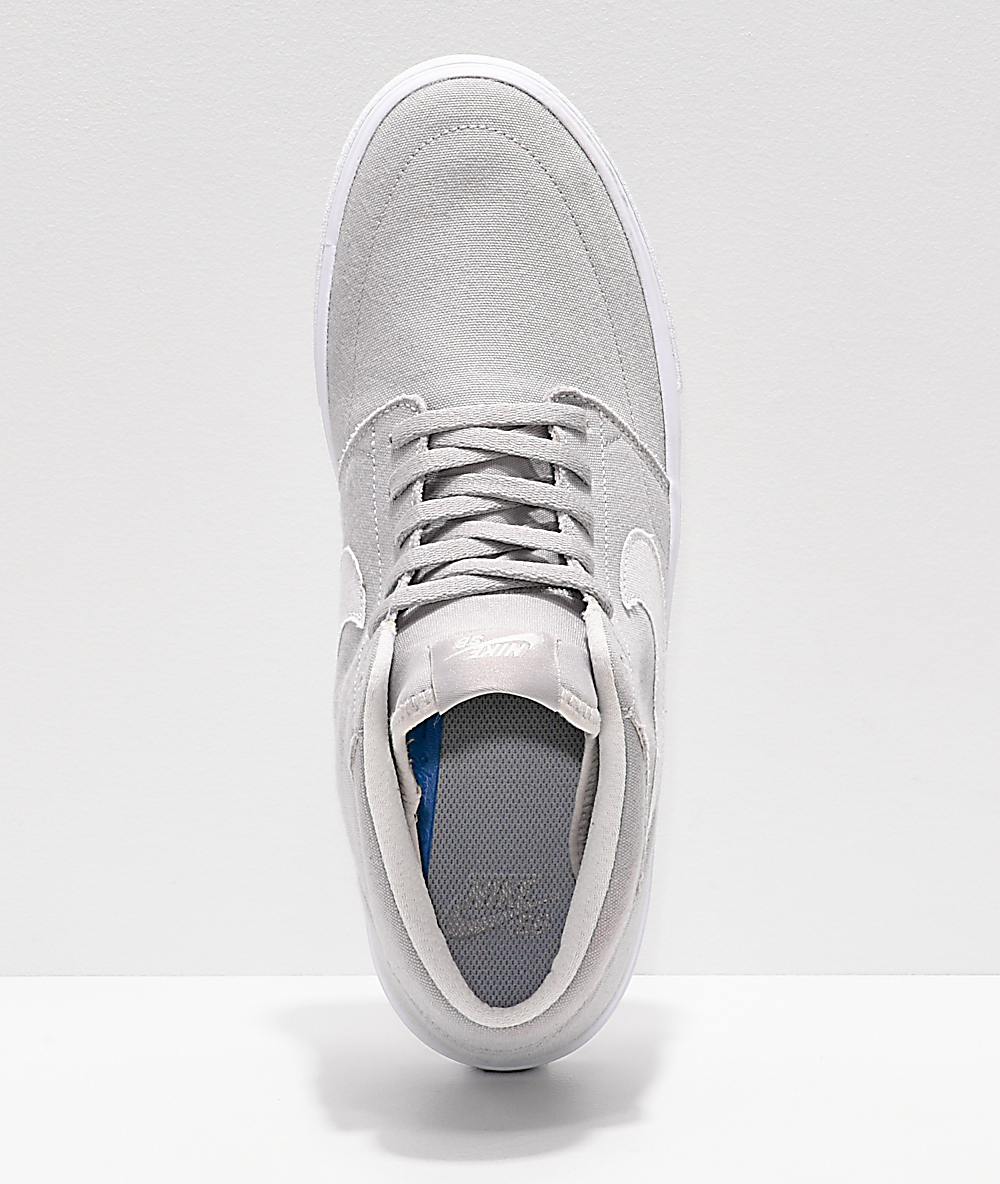 Nike SB Portmore II Mid Atmosphere zapatos de skate grises y blancos
