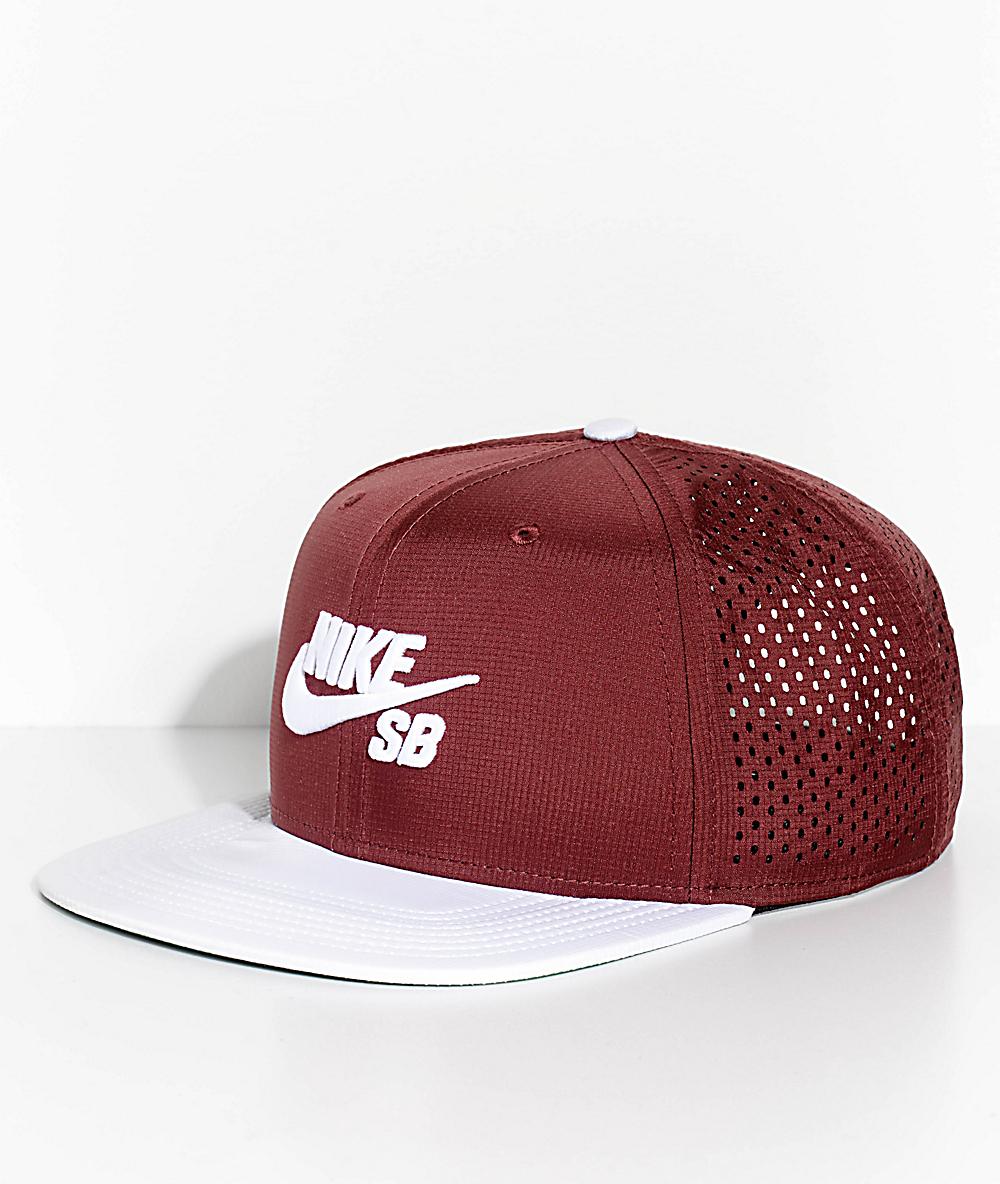 reputable site 78077 65bb2 Nike SB Pro Team AeroBill Dri-Fit Burgundy   White Snapback Hat   Zumiez