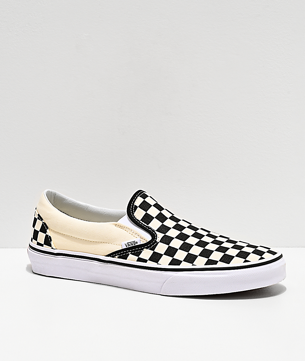 black white vans slip ons