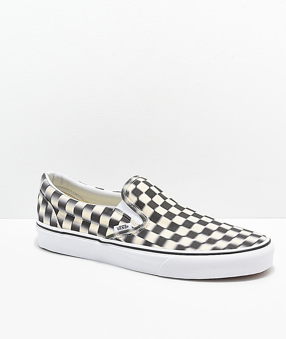 blurred checkerboard vans slip on