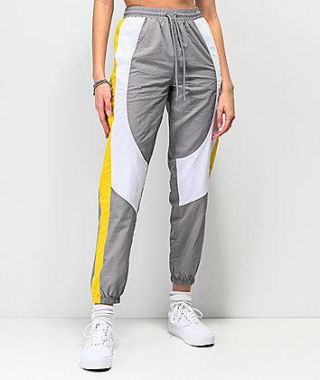 Ninth Hall Corbet pantalones de chándal grises, blancos y amarillos.