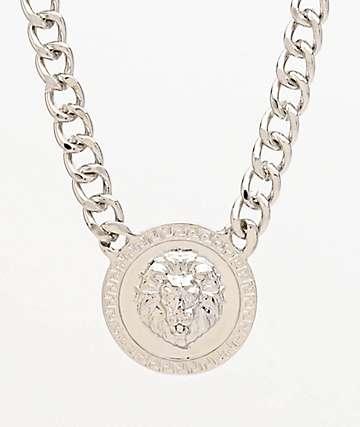 Stone + Locket collar de plata con medallón de león