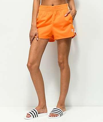 adidas 3 Stripe shorts anaranjados