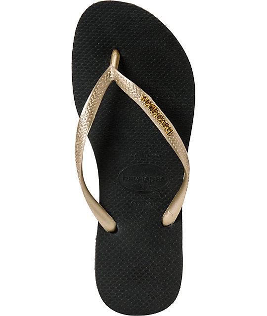 6fc97819957845 ... Havaianas Slim Logo Metallic Black   Gold Flip Flop Sandals ...
