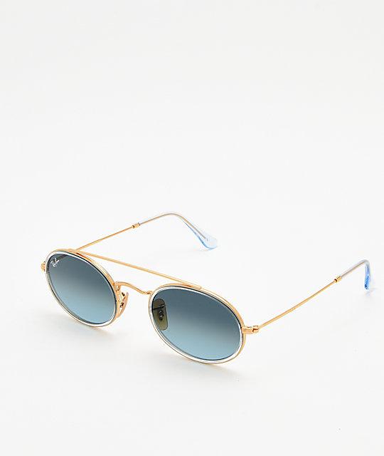 23fc9a99c0 Ray-Ban RB3847N gafas de sol ovaladas de oro y gradiente azul   Zumiez