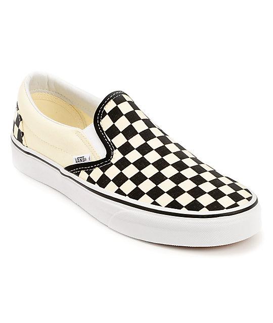 black and white checkered vans slip on