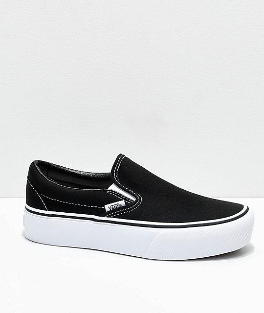 white slip on vans zumiez