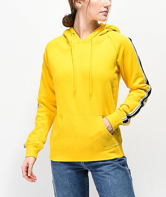 fecha de lanzamiento: bfcef 2059e Zine Tera sudadera amarilla con capucha