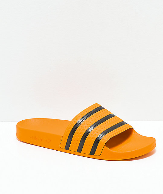 31f911675c4466 adidas Adilette Real Gold   Black Slide Sandals