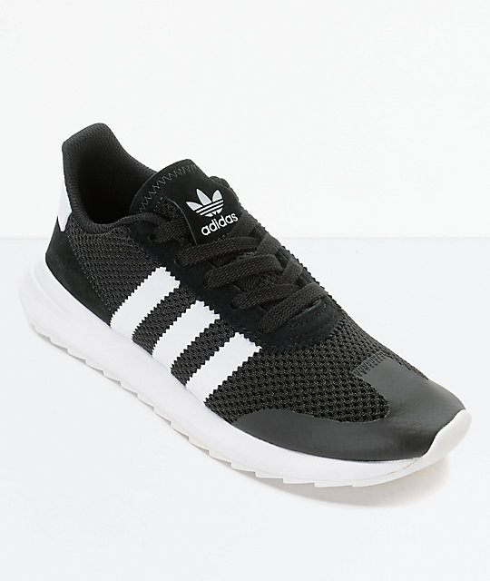 white and black adidas shoes