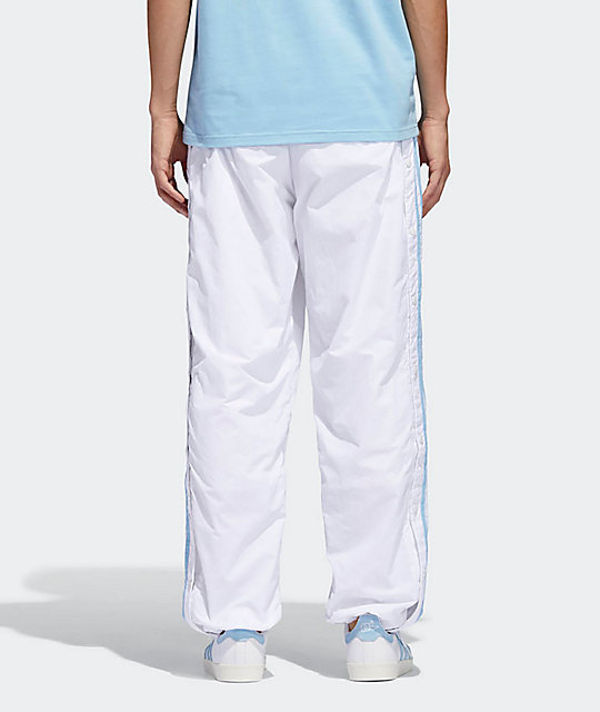 ab31c40ae65 ... adidas x Krooked White   Clear Blue Track Pants ...