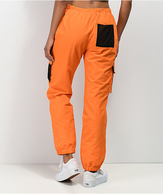 By Samii Ryan Just Leave Orange Crinkle Track Pants