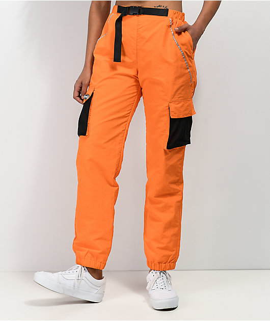 By Samii Ryan Just Leave Orange Crinkle Track Pants