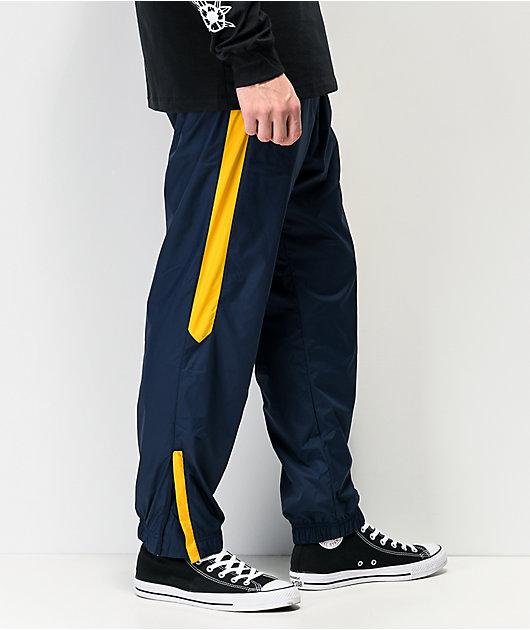 Nike SB Shield Obsidian & Dark Sulfur pantalones de chándal