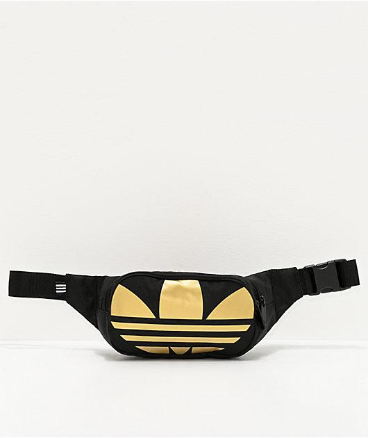 adidas Global Trefoil riñonera negra y dorada
